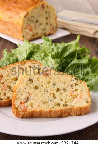 plate of cake slice and salad