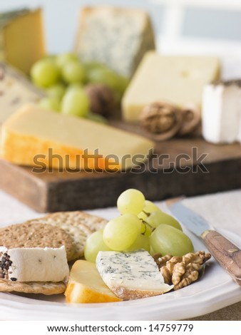 Plate of Cheese and Biscuits with a Cheese Board - stock photo