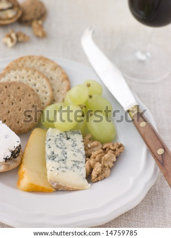 Plate of Cheese and Biscuits with a Glass of Port - stock photo