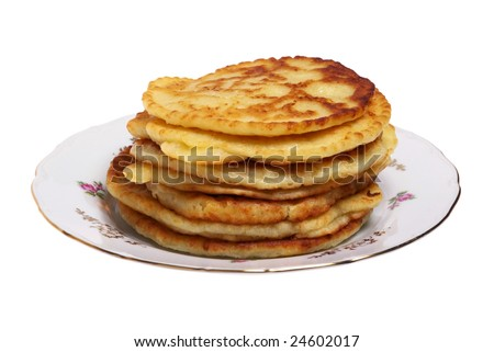 Plate of cheese pancakes on the white background.