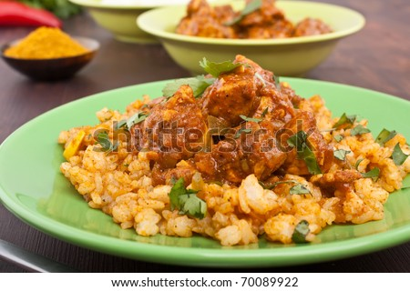 plate of chicken ( turkey ) madras  curry garnished with rice close-up - stock photo
