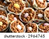 Plate of chocolate covered rice crispies with individual chocolate egg, serve for easter. - stock photo