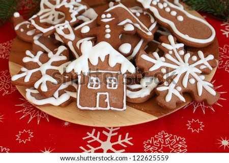 Plate of Christmas gingerbread cookies - stock photo
