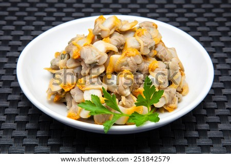 plate of cockles in vinegar and parsley - stock photo