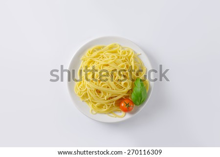 plate of cooked spaghetti on white background - stock photo