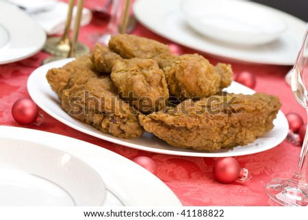 Plate of delicious fried chicken on white dish