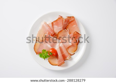 plate of dried pork ham on white background - stock photo