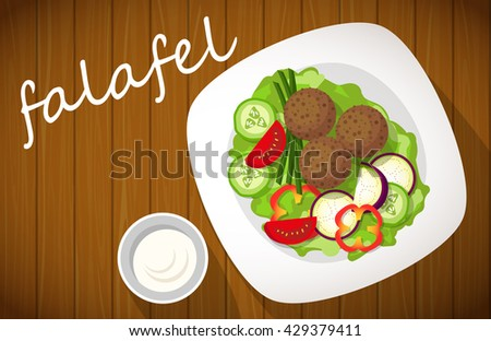 Plate of falafel on wooden table. Top view. - stock photo