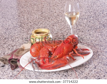 Plate of freshly cooked Gloucester crab with a glass of wine - stock photo