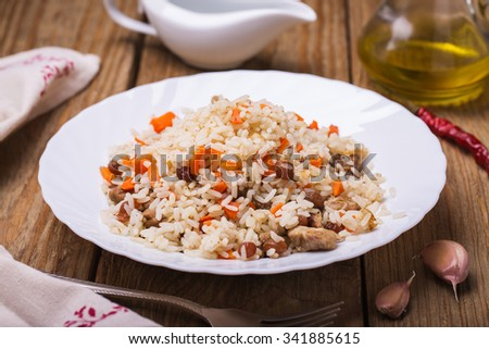 Plate of freshly prepared pilaf, closeup