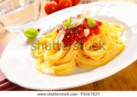 Plate of freshly prepared spaghetti bolognaise with a tomato sauce and cheese ready to be served. - stock photo