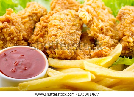 plate of fried chicken with vegetable - stock photo