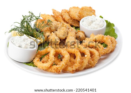 Plate of fried in batter squid and mussels with sauce, isolated on white background - stock photo