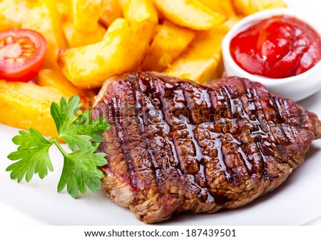 plate of grilled meat with vegetables