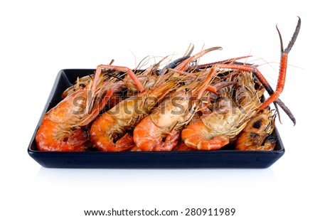 Plate of grilled shrimps isolated on the white background.