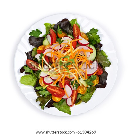 Plate of healthy green garden salad with fresh vegetables from above - stock photo