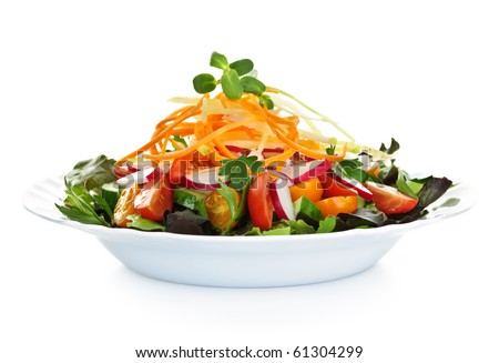 Plate of healthy green garden salad with fresh vegetables on white background - stock photo