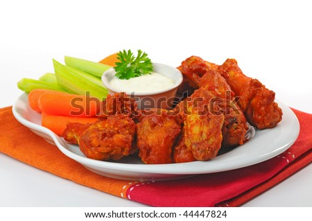 Plate of hot and spicy buffalo chicken wings. - stock photo