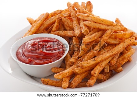 Plate of hot french fries and ketchup on a white plate - stock photo