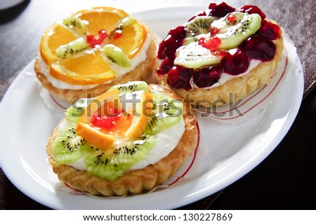 Plate of Italian fruit cakes. - stock photo