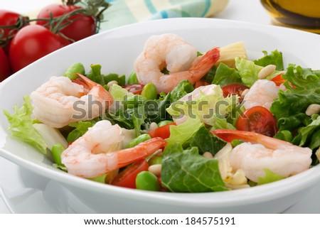 shrimp, tomatoes, artishocke hearts, Romane lettuce leaves, fava beans ...