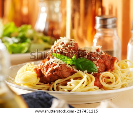 plate of italian spaghetti and meatballs - stock photo