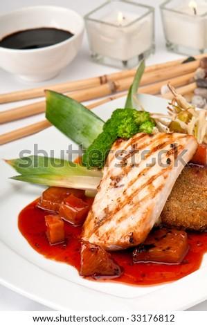 Plate of Mahi Mahi, severd with vegetables, pineapple and soy sauce. - stock photo