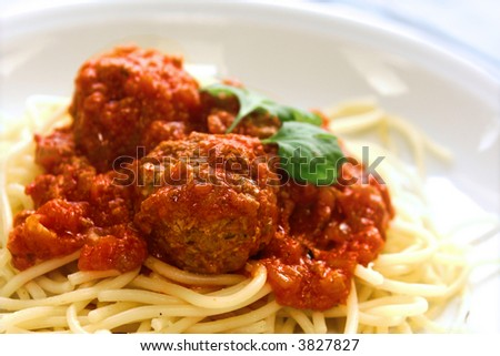 Plate of meatball spaghetti in tomato sauce and garnishing of parsley. - stock photo