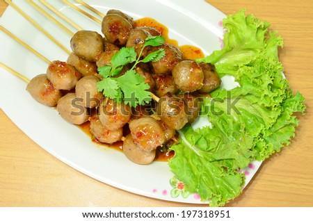Plate of meatballs in with herbs horizontal