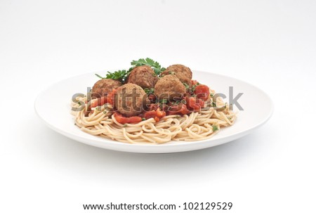 Plate of meatballs with spaghetti and tomato sauce - stock photo