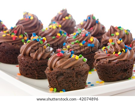 plate of mini cupcake brownies decorated with brightly colored sprinkles - stock photo