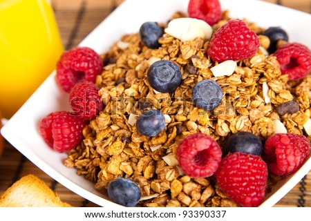 plate of muesli with fresh berries - stock photo