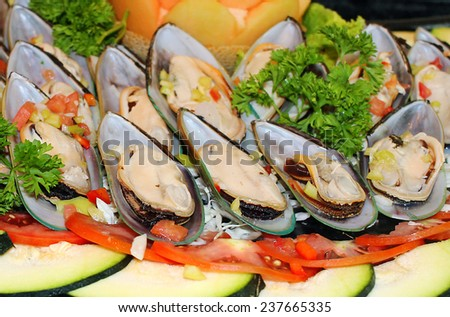 Plate of oysters with vegetables - stock photo