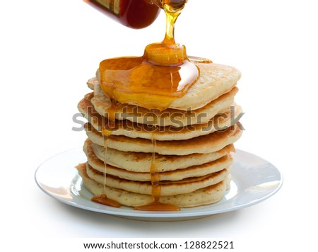 Plate of pancakes with syrup and butter. Isolated on white. - stock photo