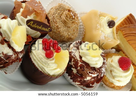 Plate of pastries with various delicious desserts - stock photo