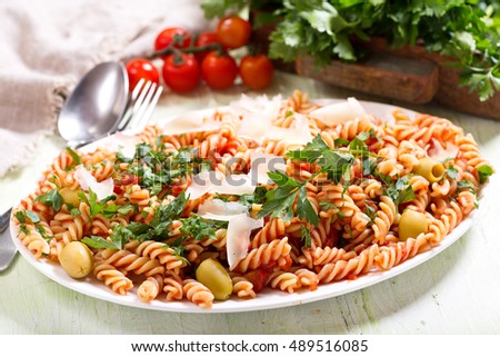 plate of penne pasta with tomato sauce and parsley