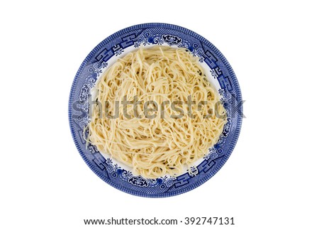 Plate of plain cooked Italian spaghetti pasta served on a blue plate ready to be served with a savory topping viewed from overhead isolated on white - stock photo