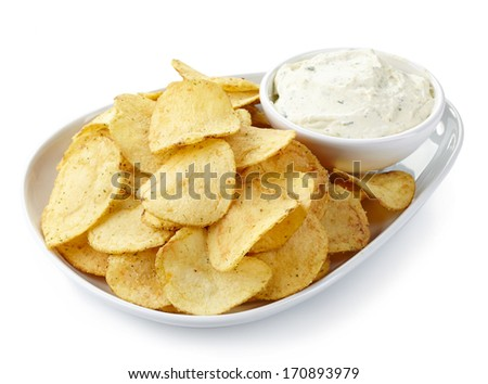 Plate of potato chips and dip isolated on white background - stock photo