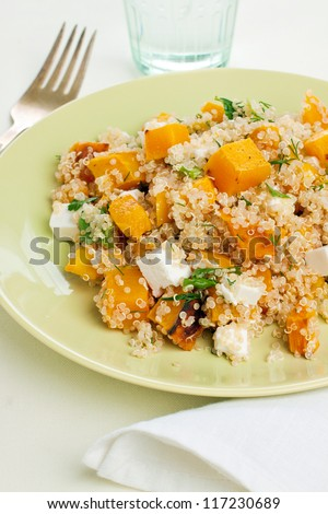 Plate of quinoa salad with feta and pumpkin - stock photo