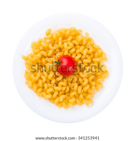 Plate of raw pasta with tomato isolated on white.