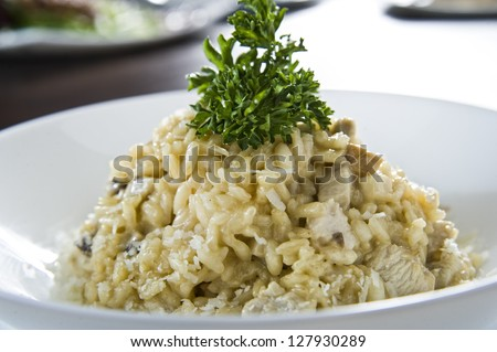 Plate of risotto traditional Italian mixed rice. - stock photo