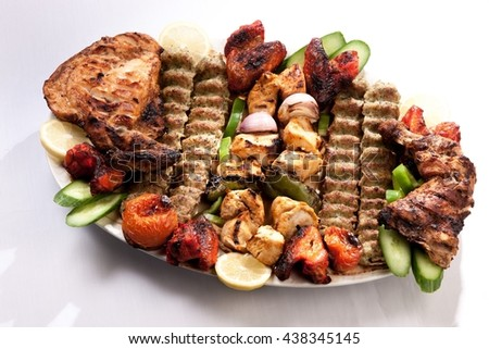 Plate of roasted meat - stock photo