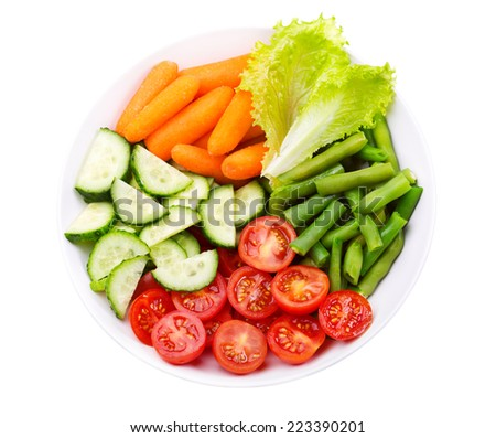 plate of salad with fresh vegetables isolated on white background