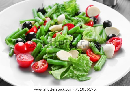 Plate of salad with green beans, closeup