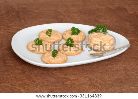 plate of salmon pate crackers - stock photo