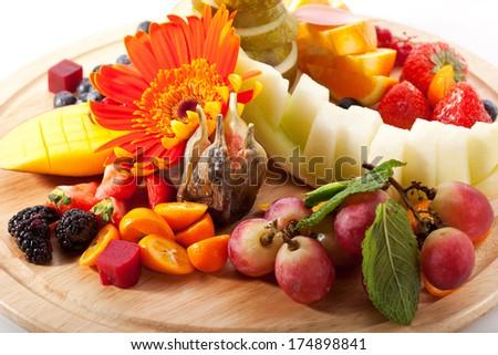 Plate of Seasonal Fruits and Berries - stock photo