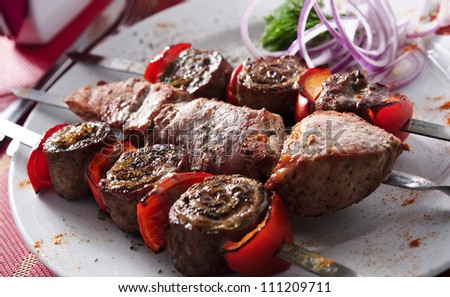 Plate of shish kebab arranged on table. - stock photo