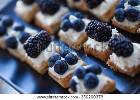 Plate of small waffles with cream cheese - stock photo