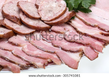 Plate of smoked meat isolated on white background - stock photo