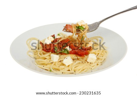 Plate of spaghetti with a fork isolated against white - stock photo